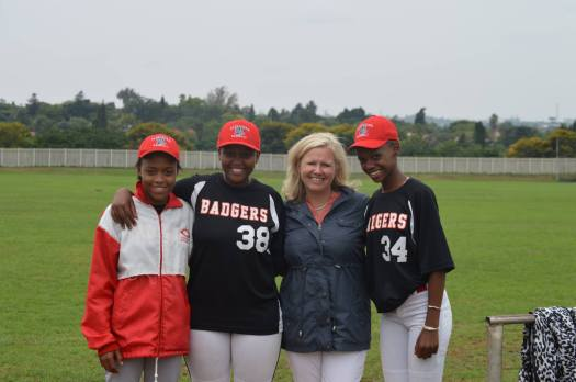 Natalie Irwin posing with Alexandra Badgers baseball players in Alexandra, South Africa