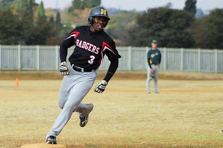 Michael Lebepe rounding the base at an Alexandra Baseball game in South Africa